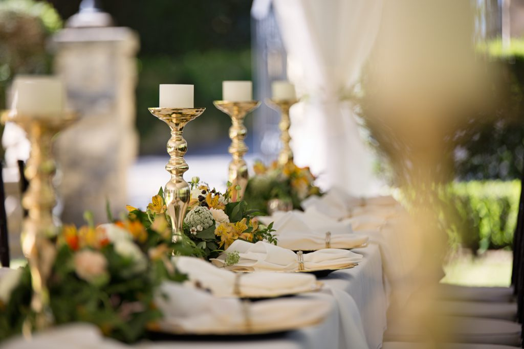 selective-focus-of-candlesticks-on-table-with-wedding-set-up-1128783